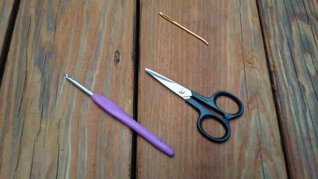 crochet hook embroidery scissors yarn needle