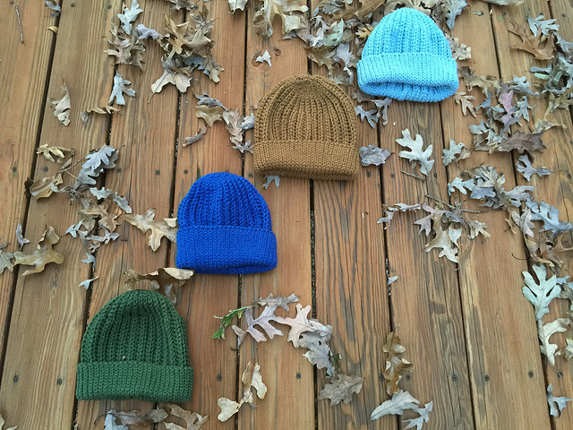 Four of ten crochet seafarer's caps all in a row
