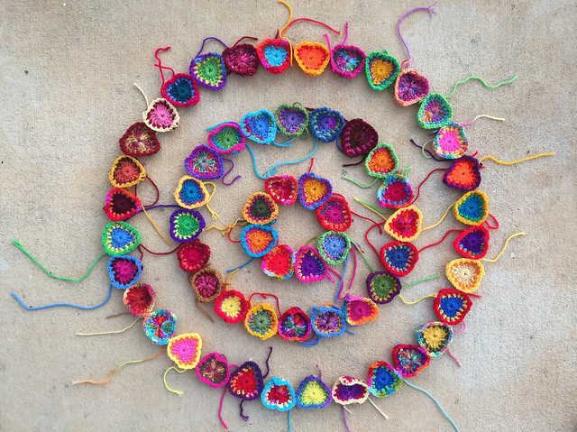 a future crochet mandala composed of concentric circles of boho crochet hearts takes shape on a winter day