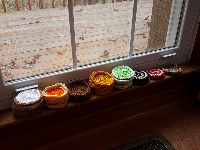 A window sill of cookies with the ends woven in on day 12 of the stash down