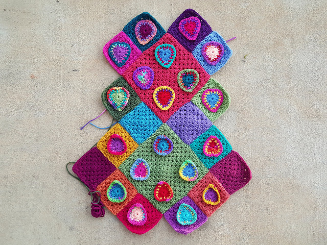 granny squares festooned with boho crochet hearts