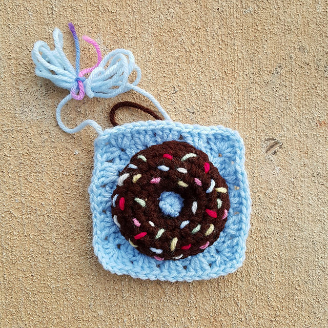 a stuffed crochet donut with sprinkles
