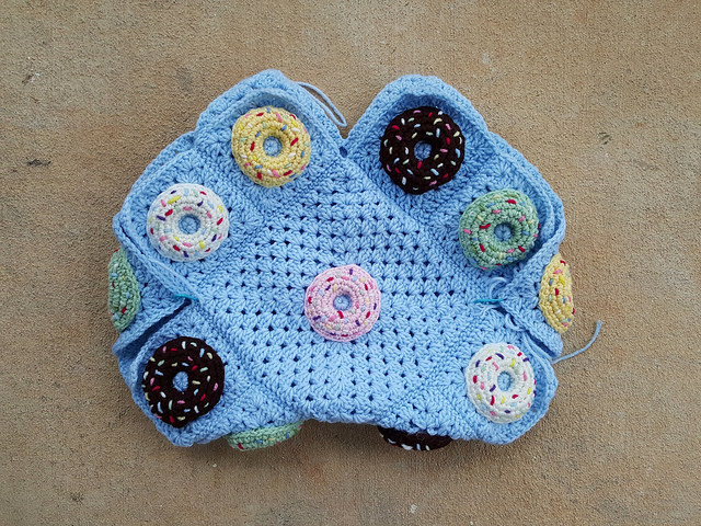 the body of a crochet donut granny square purse ready for a fabric lining