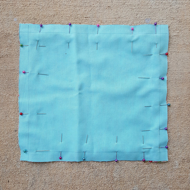The linings for the lid of the crochet lunchbox with the right sides pinned together