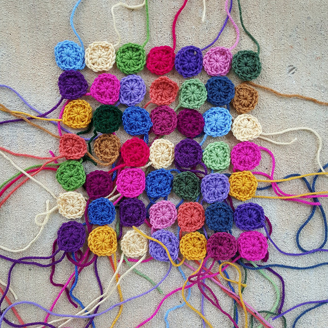Forty-nine one-round granny squares crocheted over a now missing weekend