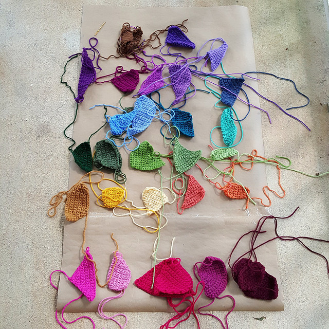 sorting crochet crazy quilt pieces by color
