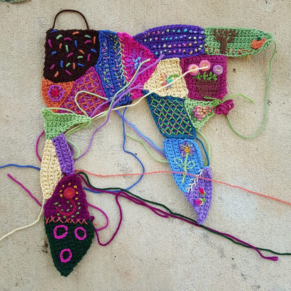 pieces with embroidery for a crazy quilt crochet blanket