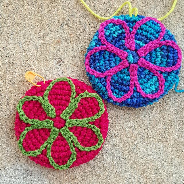 two crochet flower motifs