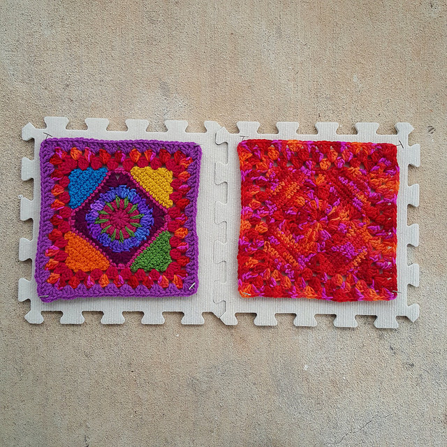 Two crochet granny squares being blocked