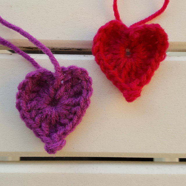 two crochet hearts