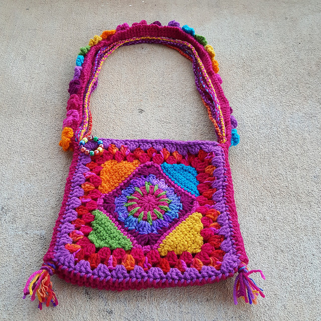 The sangria granny square purse embodying the new theory of crochet