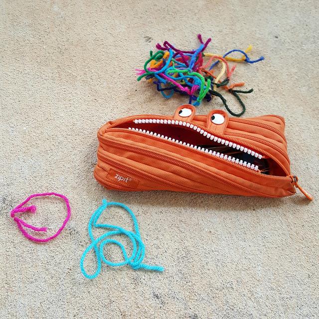 crochetbug, crochet took kit, yarn scraps, scissors, crochet hooks