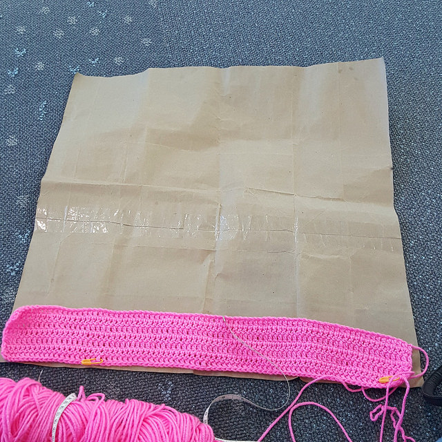 I measure a future solid pink double crochet square on a template
