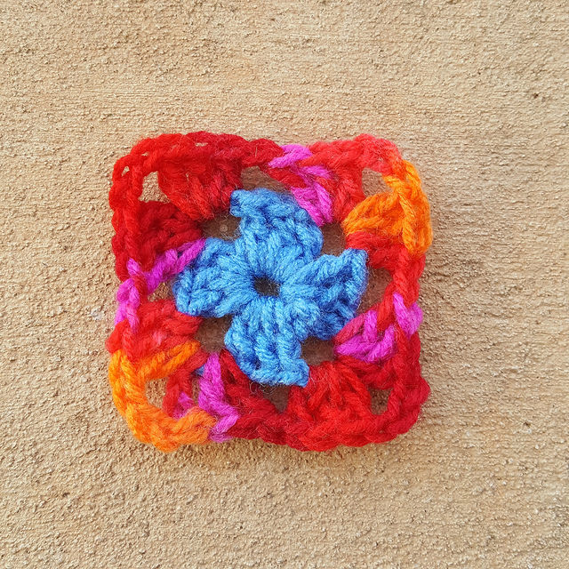 two rounds of a scrap yarn granny square