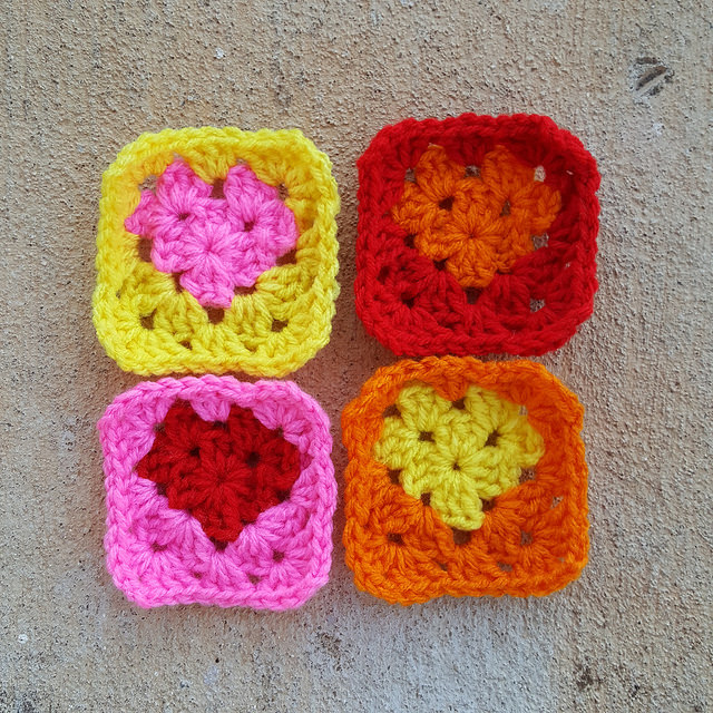 Four graphic granny square crochet hearts of the crochet hearts and roses