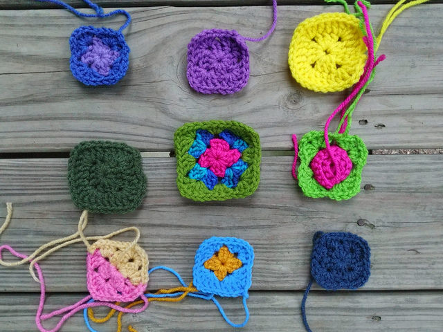 nine crochet remnants to rehabbed into crochet squares