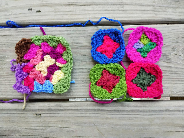 two future granny squares made from crochet remnants