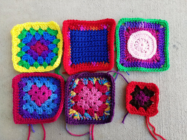 five rehabbed five inch crochet squares and a sixth, nearly completed granny square