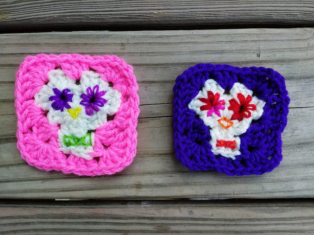 Two decorated Day of the Dead granny squares