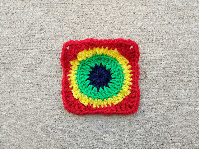 A four-and-one-half inch crochet square ready to be rehabbed