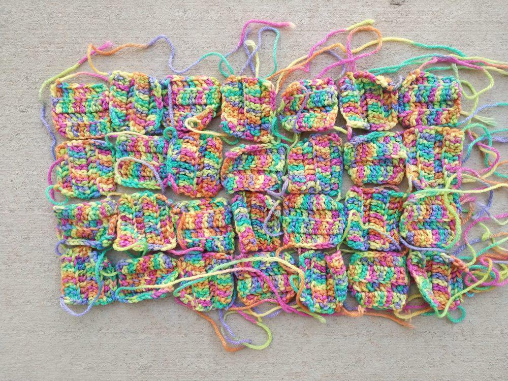 Twenty-eight lightly textured crochet squares