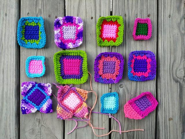 Twelve crochet remnants becoming five-inch crochet squares