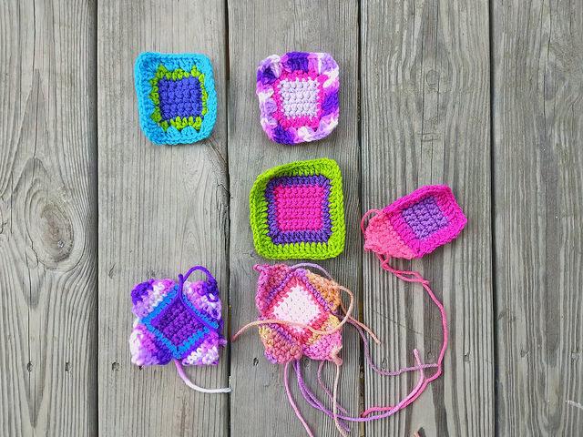 Six of twelve crochet remnants becoming five-inch crochet squares