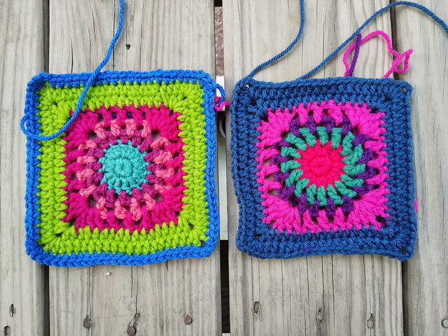 One nearly completed crochet square next to a completed crochet square