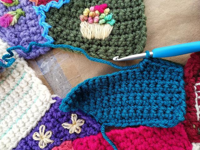 A crochet crazy quilt piece takes shape