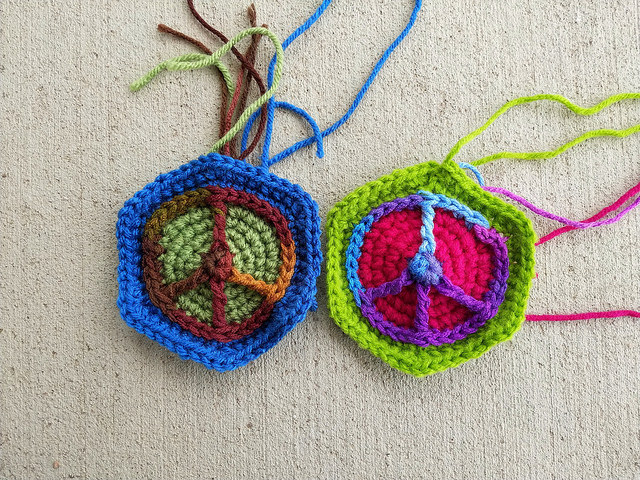 Two ironic crochet peace sign hexagons
