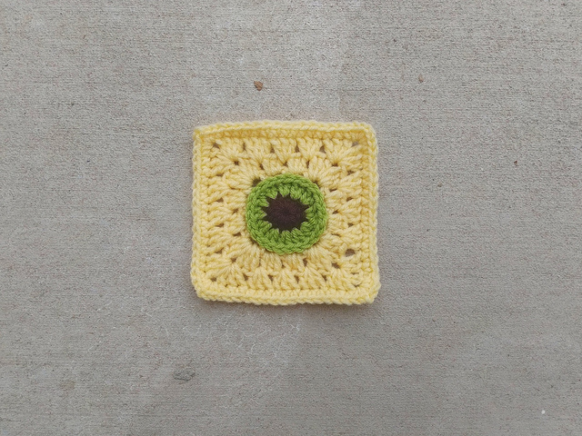 A crochet remnant rehabbed into a five-inch crochet Christmas square