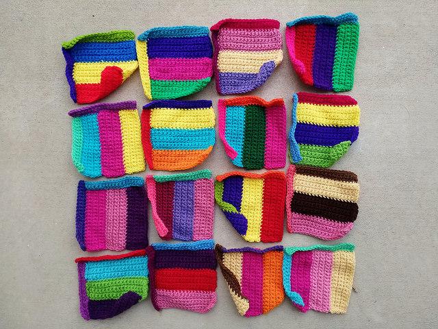 Sixteen rehabbed six-inch crochet squares