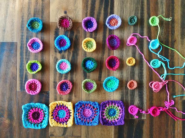 Crochet pieces of a future boho granny square purse