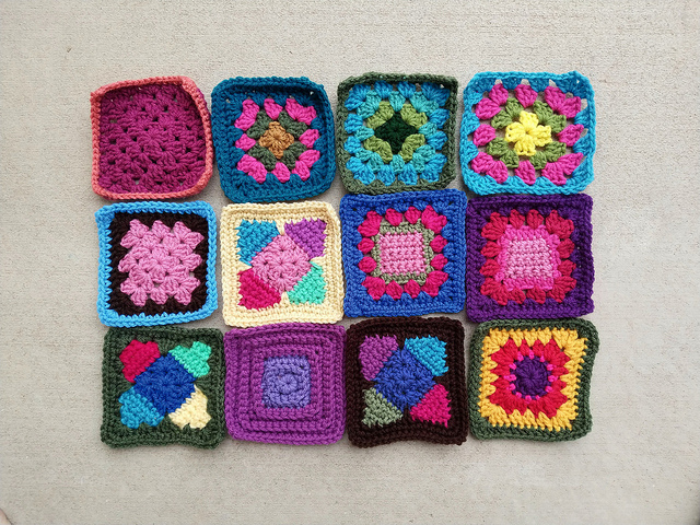 Twelve crochet remnants transformed into five-inch crochet squares; a visual demonstration of the intrinsic power of purposefulness