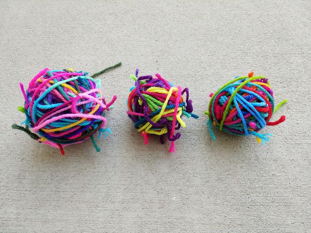 Three small magic balls of yarn scraps