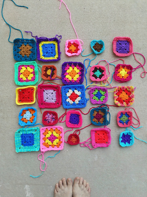 A five-by-five array of crochet remnants undergoing rehab