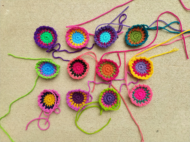 Twelve future boho crochet squares for a purse