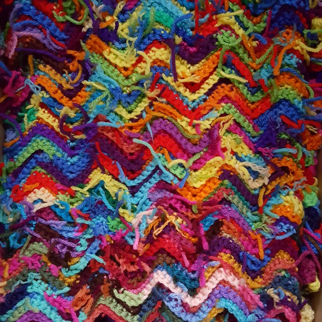 March 2018, the scrap yarn ripple afghan packed up and ready to move