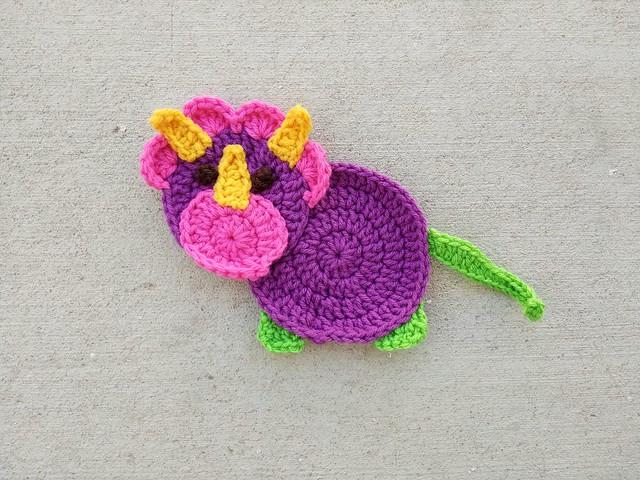 Tristan the crochet appliqué triceratops