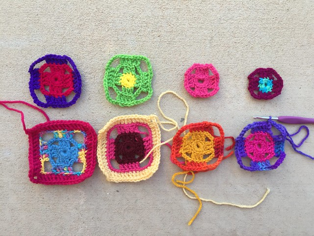 Eight future four-inch flamboyant granny squares ready to be finished
