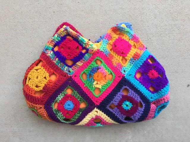 One side of the scrap yarn flamboyant swag bag