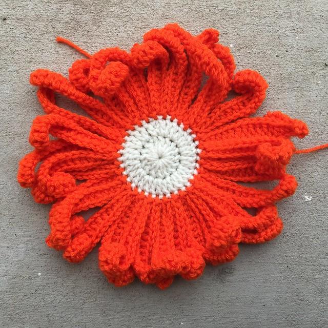 A very large crochet daisy
