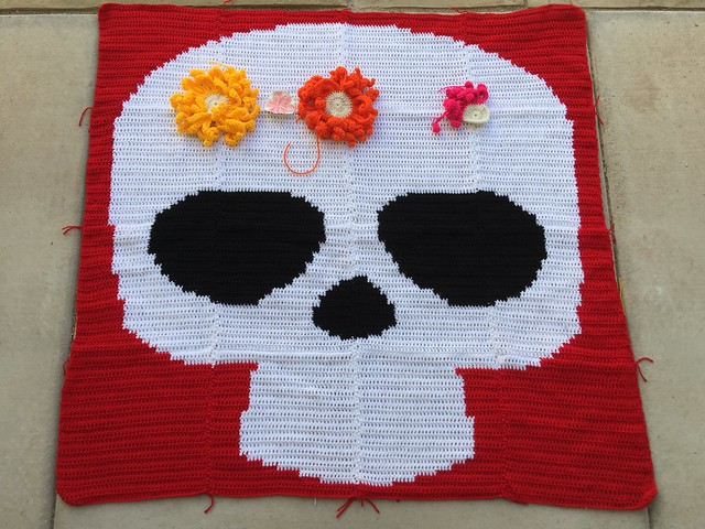 The Day of the Dead yarn bomb with the paper cut out mockup
