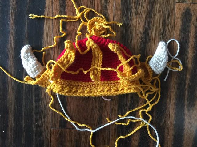 Twelve crochet pieces that provide the detail for a crochet Viking helmet