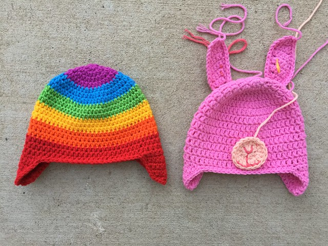Two not quite finished crochet hats for toddlers