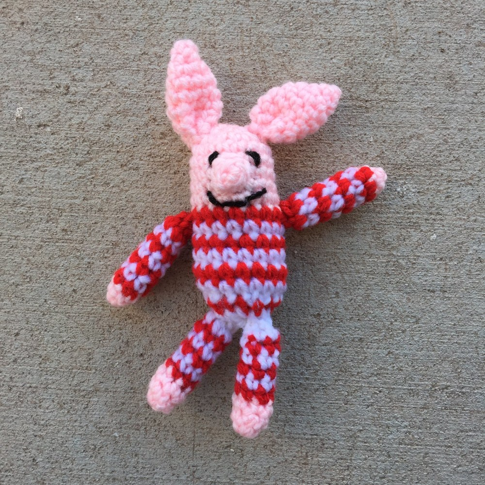 Olivette, a  mini-meta crochet pig with perfectly pointy ears