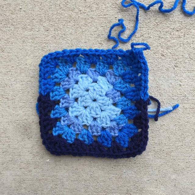 A blue scrap yarn granny square; the first new granny square of January 2020