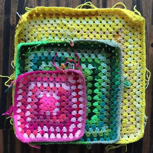 Three scrap yarn granny squares in a mitered arrangement