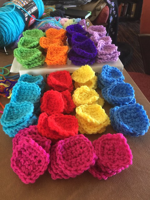 81 crochet squares in a rainbow of colors to be used to solve the puzzles on a six sudoku afghan