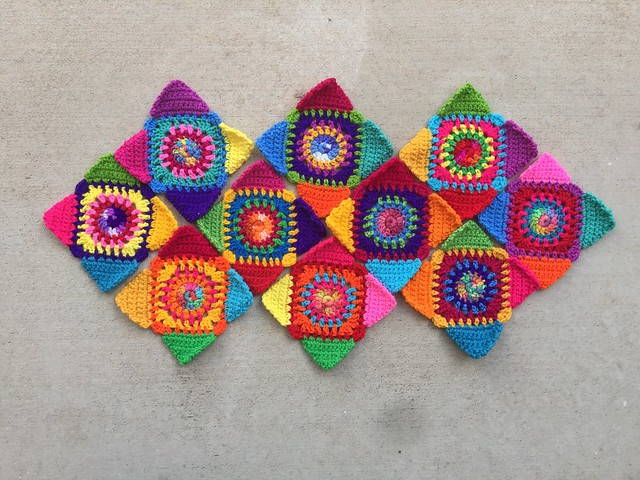 Ten multicolor crochet granny squares ready to be joined into a washable crochet purse